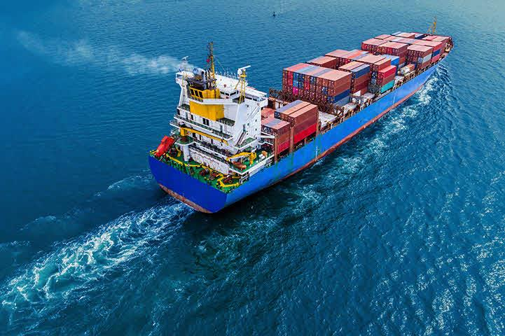 An image of a ship transporting containers of cargo in the open ocean.
